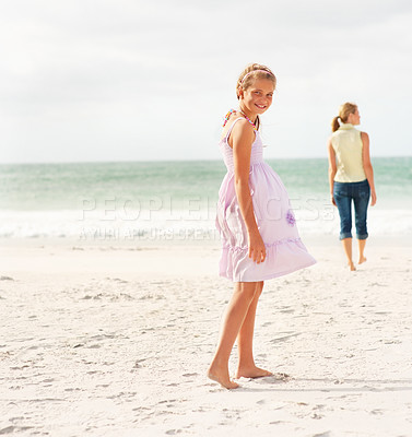 Buy stock photo Cute teenage girl at the beach with her mother on a stroll at the background