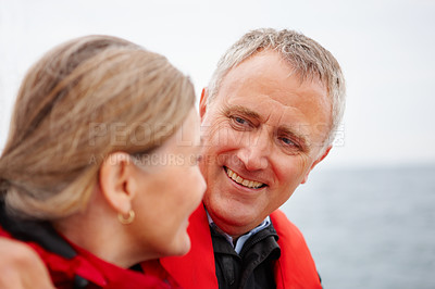 Buy stock photo Happy senior couple enjoying themselves together on a vacation on the sea