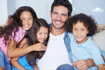 Buy stock photo Portrait of a happy single parent family sitting on a sofa and smiling at the camera