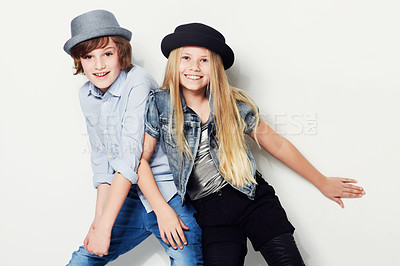 Buy stock photo Shot of two playful kids in a studio