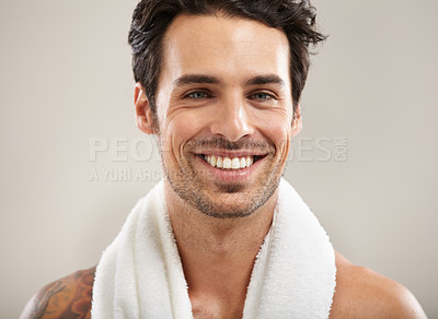 Buy stock photo Portrait of a handsome young man smiling with a towel around his neck