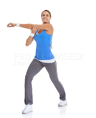 Buy stock photo Healthy young woman in sportswear stretching while isolated on white