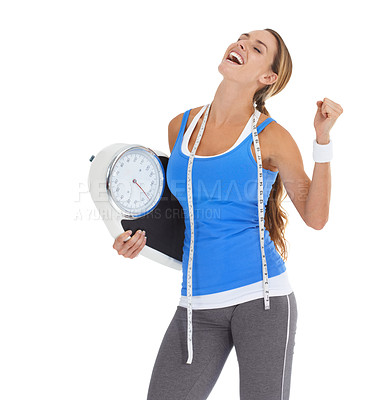 Buy stock photo Young woman in sportswear holding a scale and smiling while isolated on white