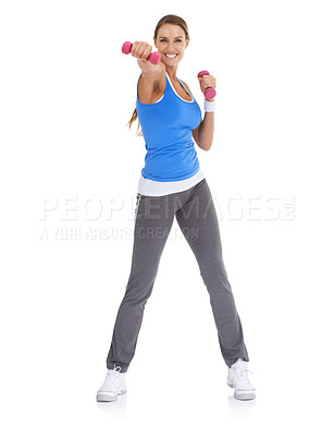 Buy stock photo Fit young woman smiling while using dumbbells against a white background