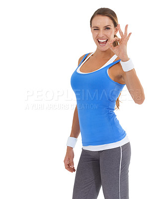 Buy stock photo Fit young woman giving the ok gesture against a white background