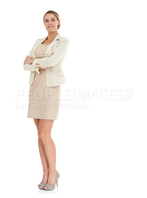 Buy stock photo An attractive businesswoman standing with her arms folded against a white background