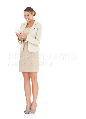 Buy stock photo An attractive businesswoman sending a text on her cellphone