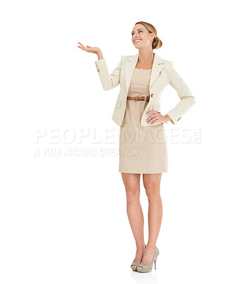 Buy stock photo A beautiful businesswoman gesturing towards copyspace against a white background