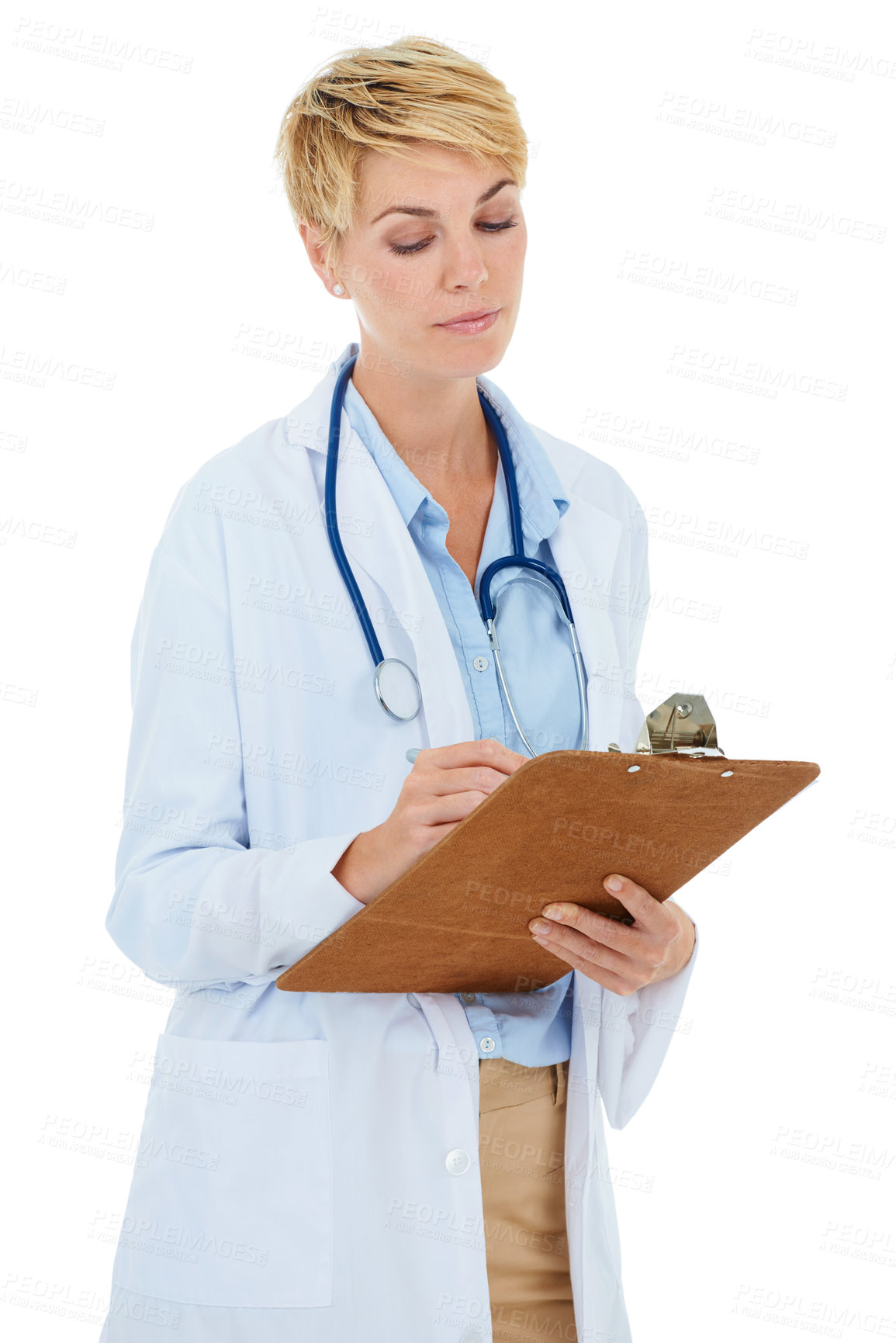Buy stock photo A young female doctor writing on a clipboard