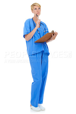 Buy stock photo A young female doctor holding a clipboard while thinking