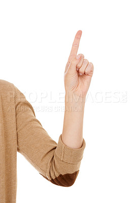 Buy stock photo Cropped image of a woman's hand pointing upwards while isolated on a white background