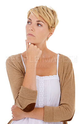 Buy stock photo Studio shot of an attractive woman looking thoughtful against a white background