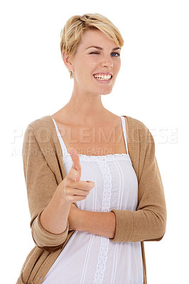 Buy stock photo A beautiful young woman pointing and winking at you while isolated on a white background