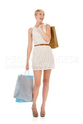 Buy stock photo An excited young woman carrying shopping bags while isolated on a white background
