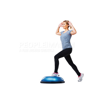 Buy stock photo An attractive young woman toning her legs on a bosu-ball
