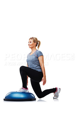 Buy stock photo An attractive young woman doing lunges on a bosu-ball