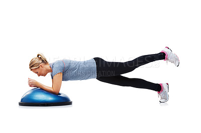 Buy stock photo A young woman working her upper body using a bosu-ball