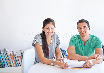 Buy stock photo Cropped shot of two businesspeople sitting at a table in the office