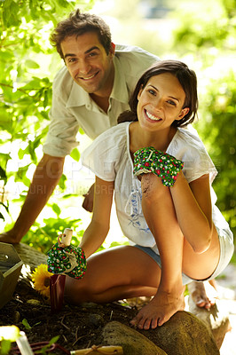 Buy stock photo Portrait of happy young couple gardening outdoors smiling