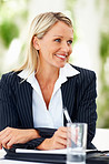 Successful gorgeous business woman smiling at a meeting