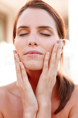 Buy stock photo Closeup of beautiful young woman pampering her fac
