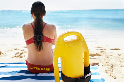 Buy stock photo A young lifeguard at the beach