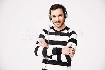 Buy stock photo Studio shot of a young trendy man listening to music