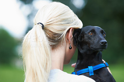 Buy stock photo A woman holding her dog
