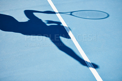 Buy stock photo A shadow of a tennis player ready to serve