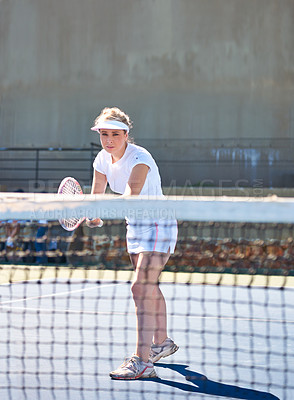 Buy stock photo A young female tennis player out on the court