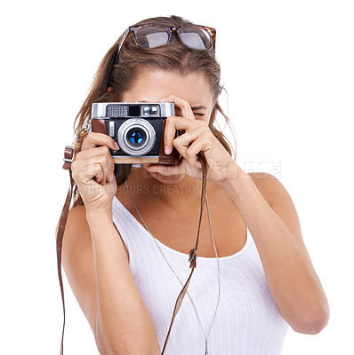 Buy stock photo Attractive young woman taking a photograph with retro camera