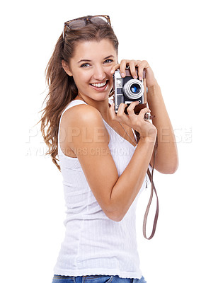 Buy stock photo A young woman holding a camera against a white background
