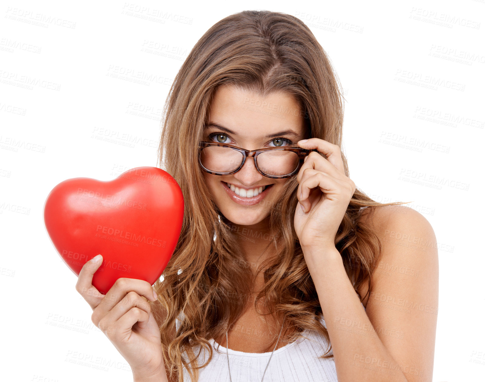 Buy stock photo Portrait of an attractive young woman holding a heart-shaped prop