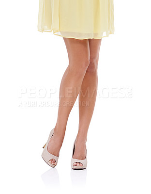 Buy stock photo A cropped image of a woman's legs in high heels and a yellow dress