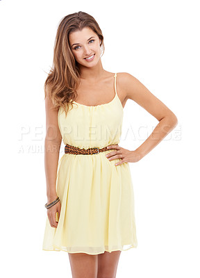 Buy stock photo A young woman in a yellow dress standing with his hand on his hips