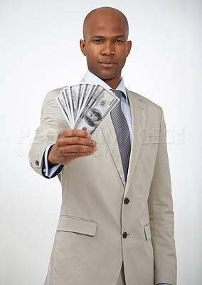 Buy stock photo A handsome businessman showing you a wad of cash while isolated on a white background