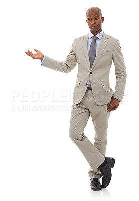 Buy stock photo A young african man pointing at copyspace