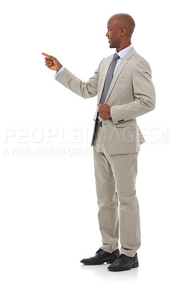 Buy stock photo An African-American businessman pointing towards copyspace