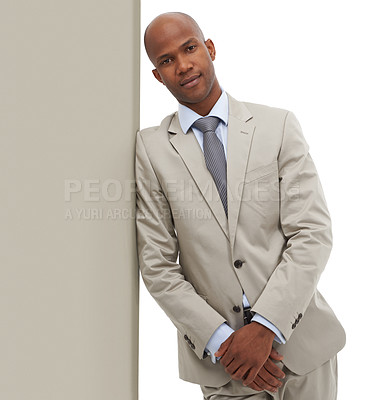 Buy stock photo An African-American businessman leaning against a wall