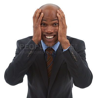 Buy stock photo Studio portrait of a frustrated businessman holding his head isolated on white