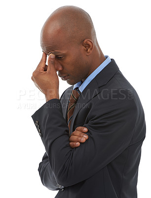 Buy stock photo An African-American businessman holding his forehead with a concerned expression