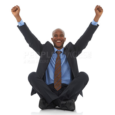 Buy stock photo A happy young african-american businessman sitting with his arms raised in an expresion of triumph
