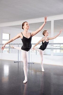 Buy stock photo A young ballerina practicing in a dance studio
