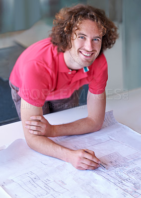 Buy stock photo A young architect working on a house plan