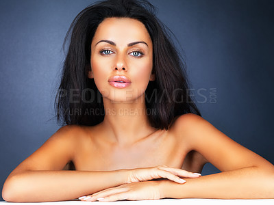 Buy stock photo Portrait of a sensuous female on blue background