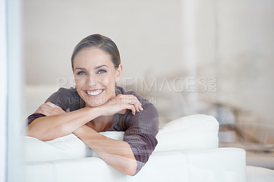 Buy stock photo Cropped shot of an attractive young woman relaxing at home