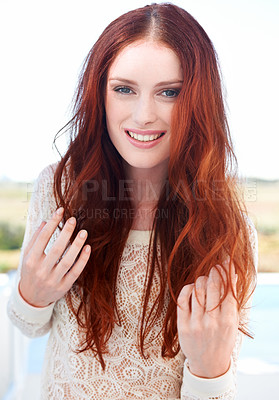 Buy stock photo A beautiful young redheaded woman smiling at the camera
