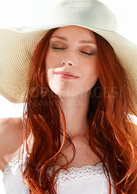 Buy stock photo A gorgeous young redheaded woman wearing a sunhat