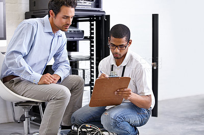 Buy stock photo A young IT specialist ready to fix a server