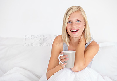 Buy stock photo Portrait of an attractive young woman holding a cup of coffee while sitting in bed